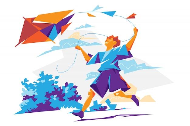 Szczęśliwy młody chłopiec bieg z latawcem