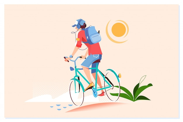 Szczęśliwy młody człowiek jedzie na rowerze na zewnątrz