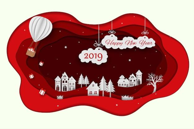 Szczęśliwy nowy rok 2019 na papierowej sztuki czerwieni tle