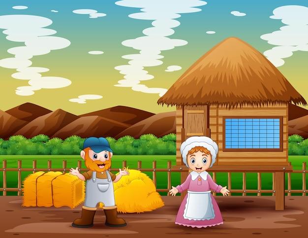 Szczęśliwy rolnik mężczyzna i kobieta w gospodarstwie