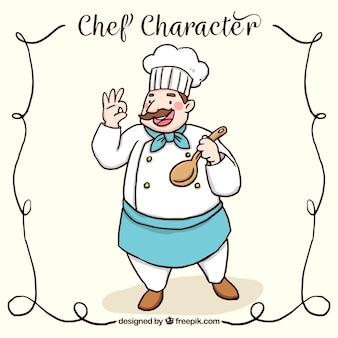 Szczęśliwy szef kuchni z drewnianą łyżką