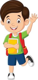 Szczęśliwy szkolny chłopiec machający ręką