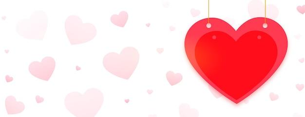 Szczęśliwy transparent pozdrowienia walentynki z czerwonym sercem