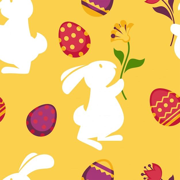 Szczęśliwy wielkanocny bezszwowy wzór z dekorującymi jajkami