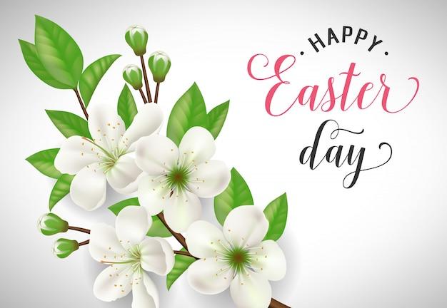 Szczęśliwy wielkanocny dnia literowanie z kwitnącą jabłczaną gałązką na białym tle
