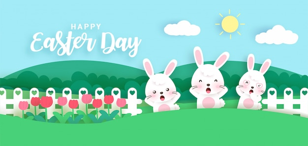 Szczęśliwy wielkanocny dzień z ślicznymi królikami w ogródzie. cięcie papieru i styl rzemiosła.