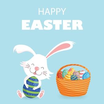 Szczęśliwy wielkanocny kartka z pozdrowieniami z dekorującymi jajkami i koszem