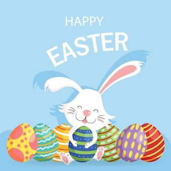 Szczęśliwy wielkanocny kartka z pozdrowieniami z dekorującymi jajkami