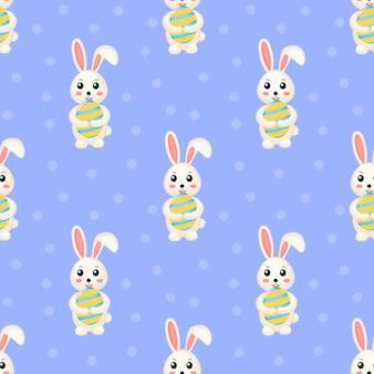 Szczęśliwy wielkanocny śliczny bezszwowy wzór uroczy króliki. królik i jajko.