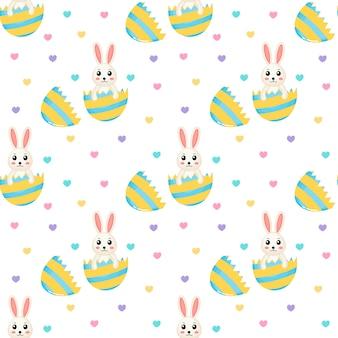 Szczęśliwy wielkanocny śliczny bezszwowy wzór uroczy króliki