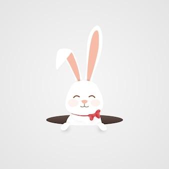 Szczęśliwy wielkanocny tło z królikiem w dziurze