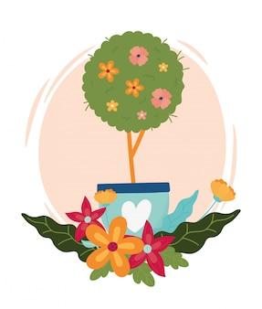 Szczęśliwy wiosny drzewo kwitnie w garnku z kierową dekoracją