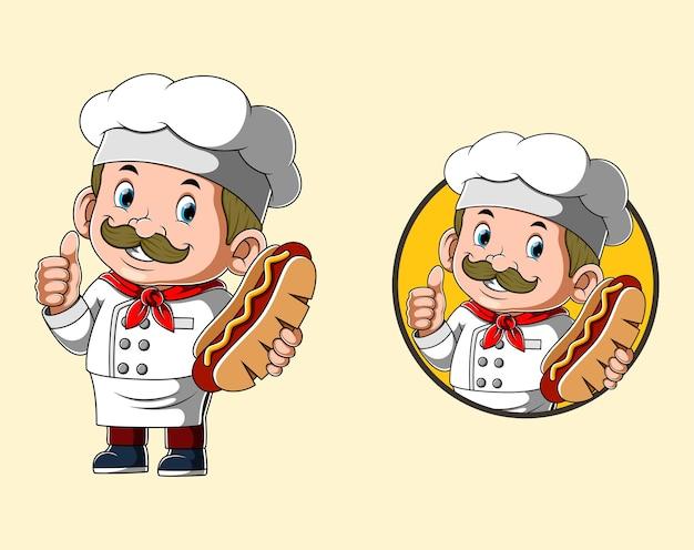 Szef kuchni trzyma dużego hot doga do restauracji z logo