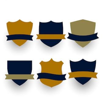 Sześć symboli tarczy lub odznak z ustawionymi wstążkami