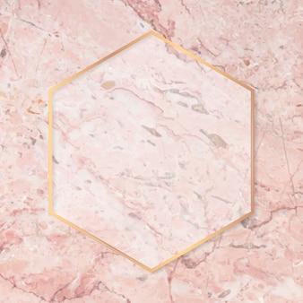Sześciokątna złota rama na różowym marmurowym wektorze tła
