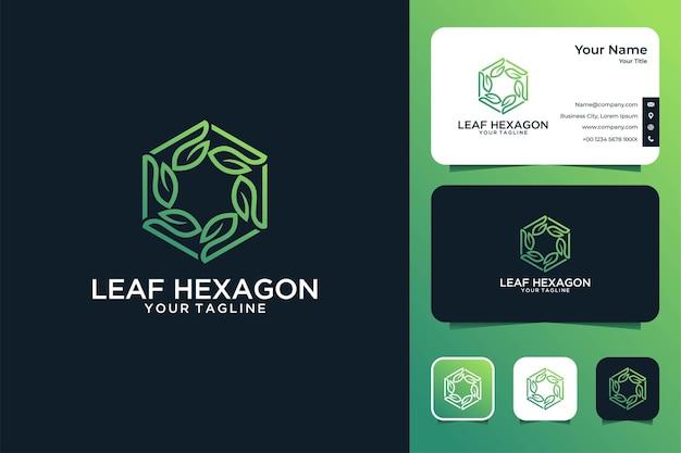 Sześciokątny projekt logo i wizytówka z zielonym liściem