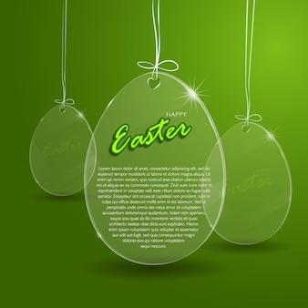 Szklane jajko wielkanocne na zielonym tle