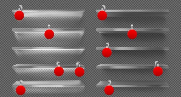 Szklane półki z diodami led i czerwonymi woblerami