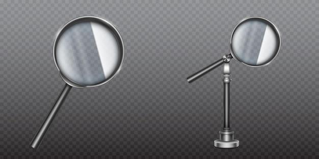 Szkło powiększające w metalowej obręczy i rączce lub uchwycie.