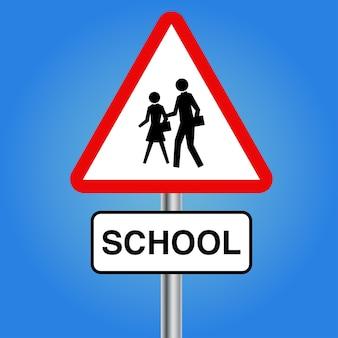 Szkoła lub pieszy z tablicą krzyżową dla dzieci z metalowym słupkiem