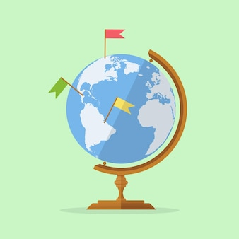 Szkolna kula ziemska z pinami mapy. planeta ziemia