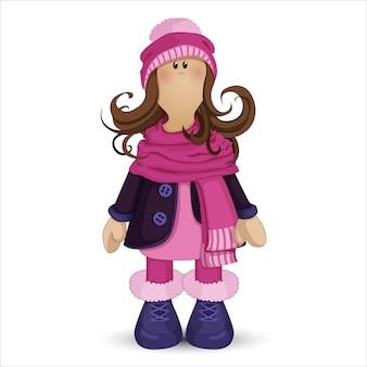 Szmaciana lalka dziewczyna w płaszcz i kapelusz.