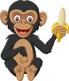 Szympans kreskówka dziecko trzyma banana