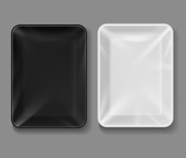 Taca z tworzywa sztucznego. opakowanie spożywcze z przezroczystą folią, czarno-białe puste pojemniki na warzywa, mięso. makieta pudełek próżniowych