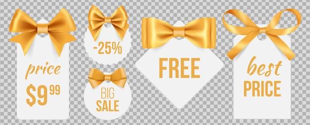 Tagi sprzedaży. złote kokardki i odznaki promocyjne. święta wyprzedaż etykiety z ozdobnymi satynowymi wstążkami na przezroczystym tle