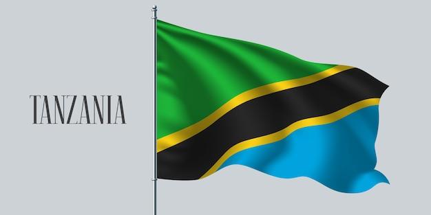 Tanzania macha flagą na maszcie.