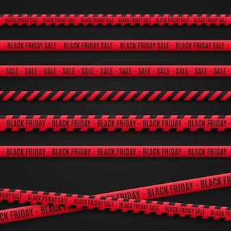 Taśmy z wyprzedaży w czarny piątek. czerwone wstążki na czarnym tle. elementy graficzne