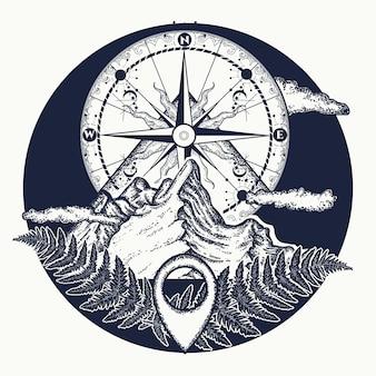 Tatuaż na szczycie góry i kompas