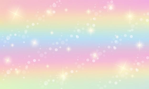 Tęcza fantasy tło. holograficzna ilustracja w pastelowych kolorach. niebo z gwiazdami i bokeh.