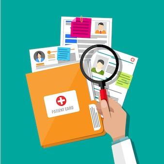 Teczka i karta pacjenta, ręczne szkło powiększające
