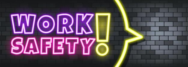 Tekst neon bezpieczeństwa pracy na tle kamienia. bezpieczeństwo pracy. dla biznesu, marketingu i reklamy. wektor na na białym tle. eps 10.