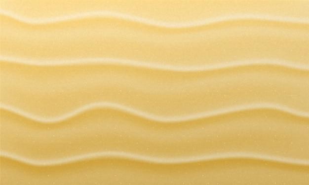 Tekstura piaszczystej plaży. tło piasek.