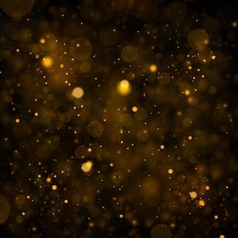 Tekstura tło czarne złoto brokat na boże narodzenie błyszczące magiczne cząsteczki kurzu efekt bokeh