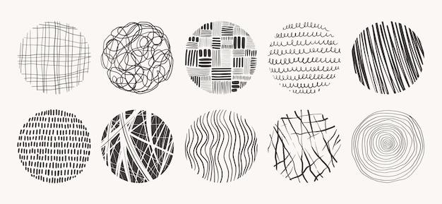 Tekstury kół wykonane tuszem, ołówkiem, pędzlem. geometryczne kształty bazgroły plam, kropek, okręgów, kresek, pasków, linii. zestaw wzorów wyciągnąć rękę.