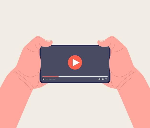 Telefon komórkowy z odtwarzaczem wideo na ekranie. aplikacja wideo w telefonie. technologie mobilnego przesyłania strumieniowego wideo