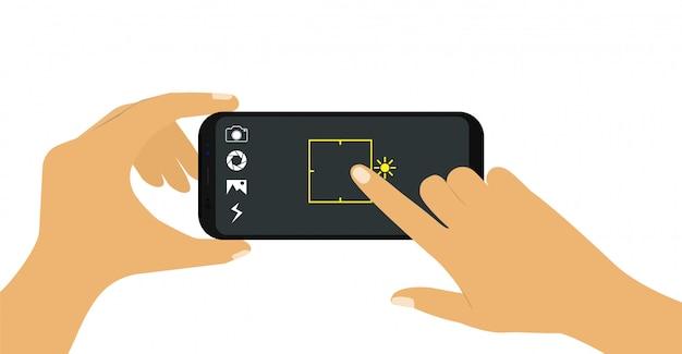 Telefon w ręku. rób zdjęcia przez telefon.