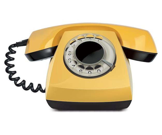 Telefon żółty vintage na białym tle.