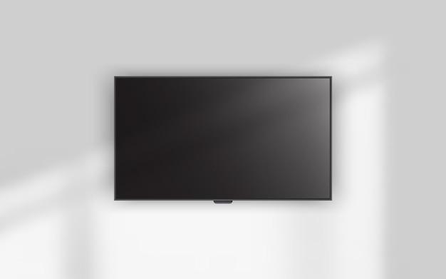 Telewizor 4k wiszący na ścianie.