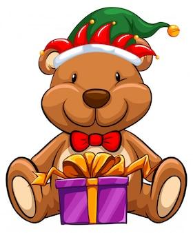 Temat bożego narodzenia z niedźwiedziem i prezentem