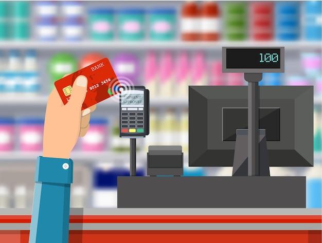 Terminal pos potwierdza płatność kartą bankową.