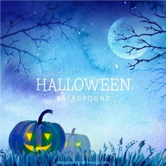 Tła akwarela z halloween dynie w niebieskim dzwonka