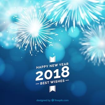 Tła z programu fireworks w niebieskim dzwonka na nowy rok