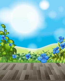 Tle przyrody z polem kwiatowym i zieloną trawą