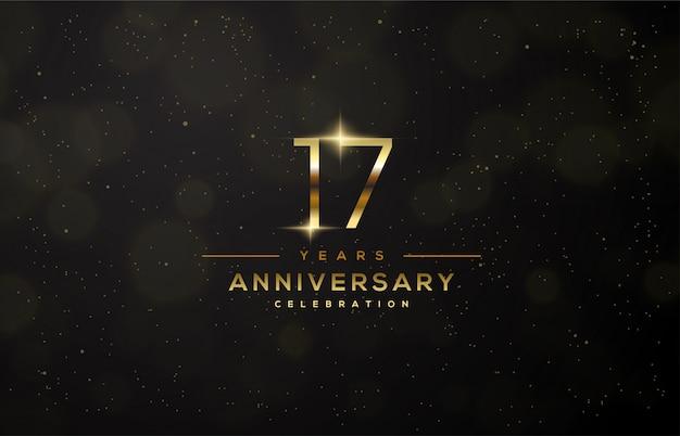 Tło 17. uroczystości ze złotymi numerami i złotym światłem.