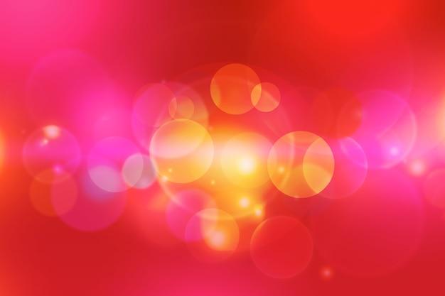 Tło bokeh z iskierkami kurzu w ciepłych kolorach