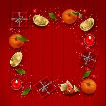 Tło chiński nowy rok z ozdobną ramką utworzony z chińskich złotych sztabek koi ryb i prezentów